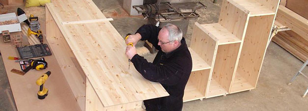 Bespoke Carpentry and Joinery - Stuart working on shelving